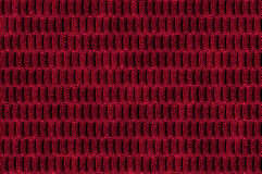 Shiny metallic cells texture - red. Abstract textured metallic background with the shiny cells relief pattern Royalty Free Stock Image