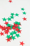 Shiny Metallic Star Embellishments. Bright red and green stars. Holidays, christmas, decorative. Shiny metallic craft star embellishments isolated on white Stock Photography