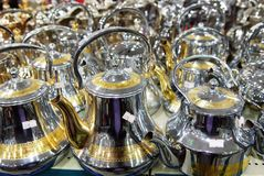 Shiny tea pots Arabian style coffee pods. Shiny metallic tea pods and coffee pods in Saudi Arabia shop for house wares. Bright shiny metal surface on the coffee Royalty Free Stock Images