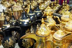Shiny tea pots Arabian style coffee pods. Shiny metallic tea pods and coffee pods in Saudi Arabia shop for house wares. Bright shiny metal surface on the coffee Royalty Free Stock Photography