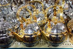 Shiny tea pots Arabian style coffee pods. Shiny metallic tea pods and coffee pods in Saudi Arabia shop for house wares. Bright shiny metal surface on the coffee Stock Image