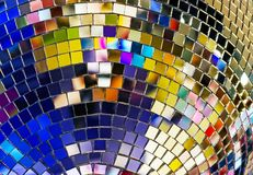 Shiny mirror ball with colorful highlights at the disco royalty free stock photos