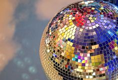 Shiny mirror ball with colorful highlights at the disco royalty free stock image