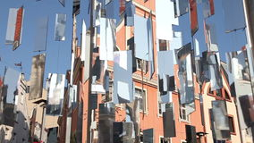 Shiny mirrors on the background of old house. Tilt up video shot of urban installation of shiny mirrors on the background of old houses. Riga, Latvia stock video footage