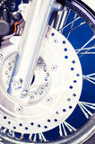 Shiny motorbike wheel and disk brakes Royalty Free Stock Photo