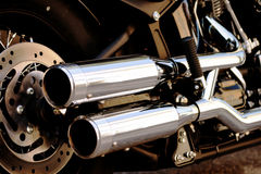 Shiny motorcycle double exhaust pipe Royalty Free Stock Photo