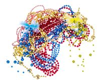 Shiny multi colored mardi gras beads including blue, red, gold and pink on white background. Studio Photo Royalty Free Stock Photography