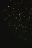 Shiny natural fireworks on dark black sky background with a litt. Le smoke Royalty Free Stock Photography