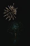 Shiny natural fireworks. On dark black sky background with a little smoke Royalty Free Stock Photos