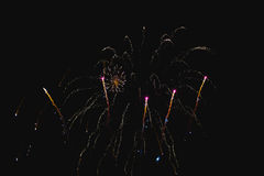 Shiny natural fireworks. On dark sky background with little smoke Stock Images