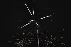 Shiny natural fireworks. On dark sky background with little smoke Royalty Free Stock Image