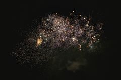 Shiny natural fireworks. On dark sky background with little smoke Royalty Free Stock Photography