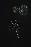Shiny natural fireworks. On dark sky background with little smoke Stock Photos