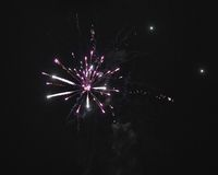 Shiny natural fireworks. On dark sky background with little smoke Stock Image