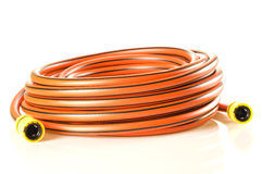 Shiny new gardening hose. Royalty Free Stock Photo
