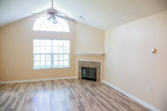 Shiny New Hardwood Floor with Fireplace in Corner royalty free stock photo