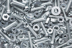 Nuts and bolts background Stock Photos