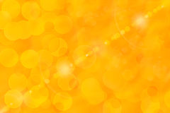 Shiny Orange Background. Orange and yellow bokeh abstract light background Royalty Free Stock Photos