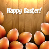 Shiny orange eater eggs on a wooden table Stock Photo
