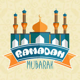 Shiny paper mosque for Ramadan Mubarak celebration. Stock Photo