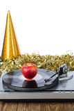 Shiny party hat with record player and apple. On a white background royalty free stock image