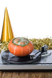 Shiny party hat with record player and pumpkin. On a white background stock photos