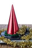 Shiny party hat on record player. On a white background royalty free stock photos