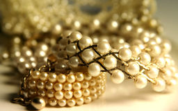 Shiny pearls. Various pieces of pearl jewelry stock image