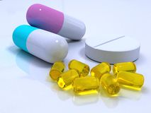 Shiny pills on the white surface Royalty Free Stock Images