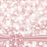 Shiny pink background with bow Royalty Free Stock Photo