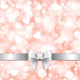 Shiny pink background with gift silver bow Royalty Free Stock Photography