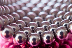 Shiny pink beads background Stock Image