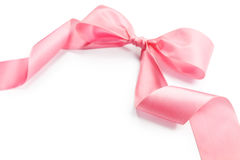 Shiny pink satin holiday ribbon and bow. Isolated on white background with copy space Stock Photography