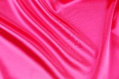 Shiny pink silk background. Royalty Free Stock Image