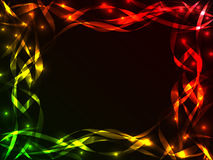 Shiny plasma ribbon frame. Great chaotic plasma frame with multiple colorful and shiny ribbons crossing each other over black with burst of lights, copy space in Royalty Free Stock Photography
