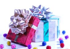Shiny presents with ribbons and bows on white back Royalty Free Stock Photography