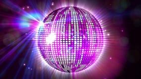Shiny purple disco ball spinning around Stock Images