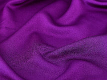 Shiny purple fabric background Stock Images