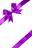 Shiny purple satin ribbon on white background Royalty Free Stock Image