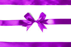 Shiny purple satin ribbon on white background Royalty Free Stock Photos