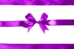 Shiny purple satin ribbon on white background Royalty Free Stock Photos