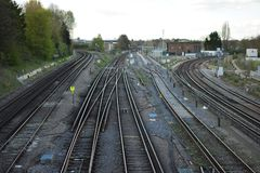 Shiny railway lines going three directons. Shiny railway lines split in to three ways. A journey split in to three Royalty Free Stock Images