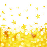 Shiny rain of golden stars background Royalty Free Stock Images