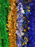 Shiny Rainbow Colored Christmas Foil Tinsel Garland Stock Image