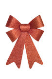 Shiny Red Bow. Shiny Red Christmas Bow, isolated w/clipping path Royalty Free Stock Photo
