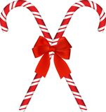 Shiny Red Christmas Candy Cane With Bow Royalty Free Stock Photography