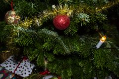 A shiny red Christmas ornament ball, winter holidays background. stock photos