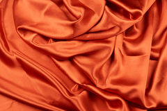 Shiny red copper silk Stock Photography