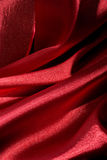 Shiny red fabric folds Royalty Free Stock Photos