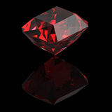Shiny red gemstone with a reflection. On a black background Stock Photography